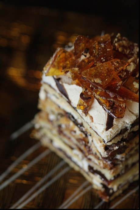 Shortbread cake layers with Plum Butter, Walnuts and Meringue layered with Custard Buttercream.