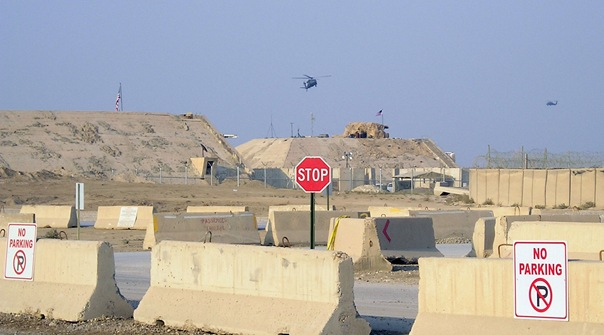 Adjacent to USAF Camp Sather, two hardened Iraqi Air Force bunkers show the battle damage incurred from attacks prosecuted by coalition bombers and attack aircraft in the first gulf war. Note the presence of the blast fragmentation T-Walls topped with razor wire at far right, beyond which lies the active flight line.