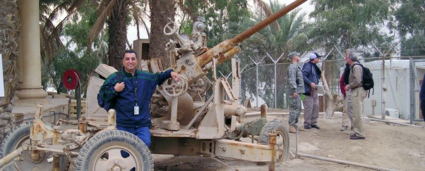 David Tashji stands at the ready to engage air vehicle threats with a destroyed soviet era anti-aircraft weapon at the Victory Base Complex IqAF Air Operatins Center.