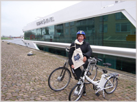 Glynis with Silver Travel Bag and the bicycle!