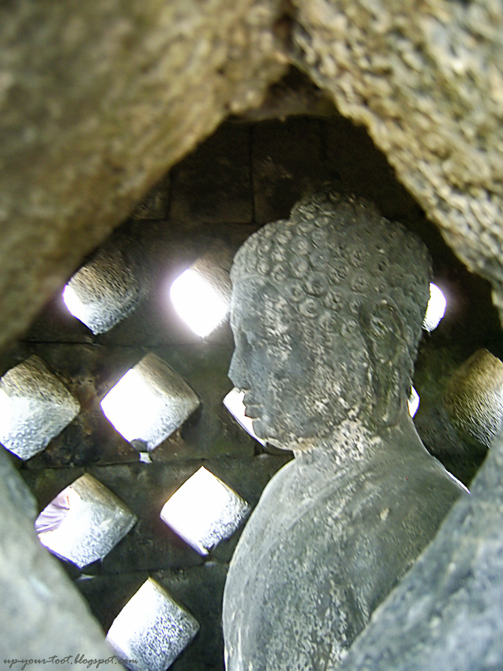Buddha inside stupa at Borobudur