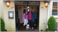 Pam and husband Steve with their little dog Rosie