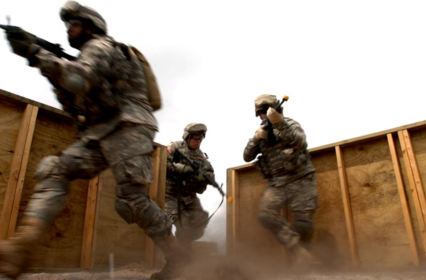 U.S. Army Soldiers practice room clearing procedures during military operations in an urban terrain training at Fort Dix, N.J., on May 11, 2007.  The soldiers are assigned to Headquarters and Headquarters Company, 58th Infantry Brigade Combat Team.  DoD photo by Staff Sgt. Jon Soucy, U.S. Army.  (Released)