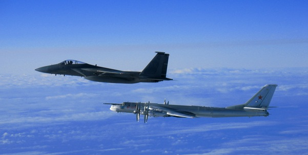 A U.S. Air Force F-15C Eagle aircraft intercepts a Russian Tu-95 Bear bomber aircraft which neared the U.S. Navy aircraft carrier USS Nimitz (CVN 68) south of Japan Feb. 9, 2008. The bomber neared the vicinity of the carrier resulting in the fighter intercept. Nimitz was transiting through the Western Pacific on a regularly scheduled deployment when the incident occurred. DoD photo courtesy of U.S. Navy. (Released).