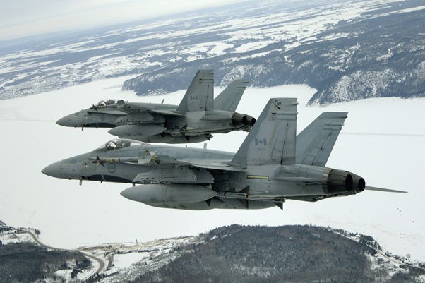 Two aircraft from 425 Tactical Fighter Squadron, 3 Wing Bagotville, fly over l'arrondissement Chicoutimi of ville de Saguenay.